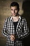 Man with cool plaid shirt posing Stock Photos