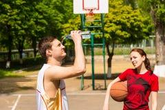 Man Cooling Down During Basketball Game Break Stock Image
