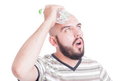 Man cooling his head with cold water in plastic bottle Royalty Free Stock Images