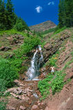 Man Cooling Off Gorgeous Little Waterfall in High Alpine Mountai Stock Photography
