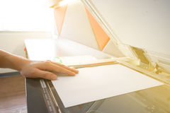Man copying paper from Photocopier sunlight from window Royalty Free Stock Photos