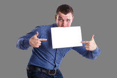 Man and copyspace. Man holding an empty table, isolated on background Stock Images