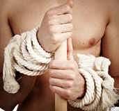Man with a cord on hands.  Stock Photo