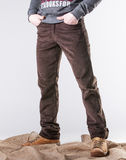 A man in corduroy trousers royalty free stock photography