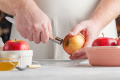 Man with core removed with special kitchen utensil specifically Stock Photography