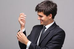 Man corrects a cuff link Stock Image