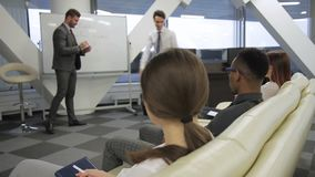 The man corrects the mistkes of his colleague on the presentation in the modern office. stock footage
