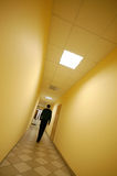 Man in corridor Stock Images
