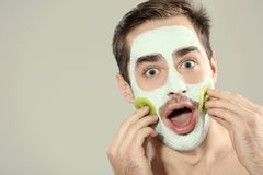 Man with cosmetic mask on face royalty free stock photo