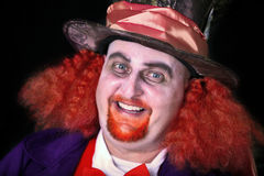 Man in costume. Man dressed in halloween costume with orange hair Royalty Free Stock Image