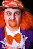Man in costume. Man dressed in halloween costume with orange hair Royalty Free Stock Photos