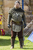 Man in costume. Medieval Display. Warkworth, Northumberland. England. UK. Royalty Free Stock Images