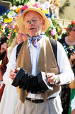 Man in costume play instrument during the carnival Stock Images