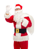 Man in costume of santa claus with bag Royalty Free Stock Photography