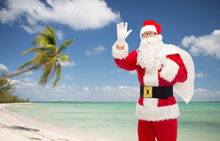 Man in costume of santa claus with bag Stock Photos