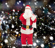 Man in costume of santa claus with bag Stock Image