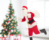 Man in costume of santa claus with bag Royalty Free Stock Image