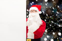 Man in costume of santa claus with billboard Stock Image