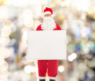 Man in costume of santa claus with billboard Royalty Free Stock Images
