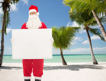 Man in costume of santa claus with billboard Royalty Free Stock Photography