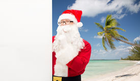 Man in costume of santa claus with billboard Stock Images