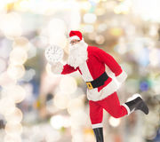 Man in costume of santa claus with clock Royalty Free Stock Images