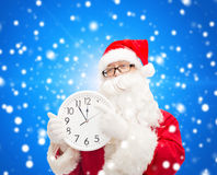Man in costume of santa claus with clock Royalty Free Stock Photos