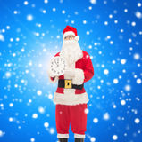 Man in costume of santa claus with clock Royalty Free Stock Photography