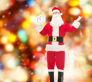 Man in costume of santa claus with clock Stock Photography