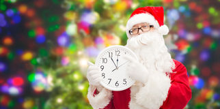 Man in costume of santa claus with clock Royalty Free Stock Photo