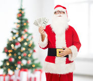 Man in costume of santa claus with dollar money Royalty Free Stock Photos