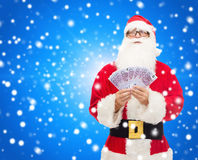 Man in costume of santa claus with euro money Royalty Free Stock Photo