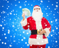 Man in costume of santa claus with euro money Royalty Free Stock Image