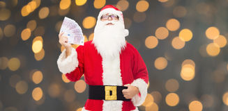 Man in costume of santa claus with euro money Stock Photography