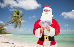 Man in costume of santa claus with euro money Royalty Free Stock Images