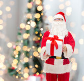 Man in costume of santa claus with gift box Stock Image