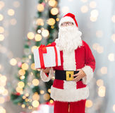 Man in costume of santa claus with gift box Royalty Free Stock Photos