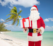 Man in costume of santa claus with gift box Royalty Free Stock Photography