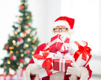 Man in costume of santa claus with gift boxes Stock Photography