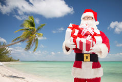 Man in costume of santa claus with gift boxes Royalty Free Stock Photography