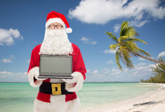 Man in costume of santa claus with laptop Royalty Free Stock Photography