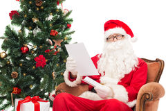 Man in costume of santa claus with letter Stock Photo