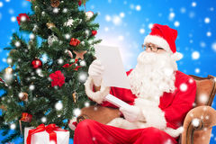 Man in costume of santa claus with letter Royalty Free Stock Photography