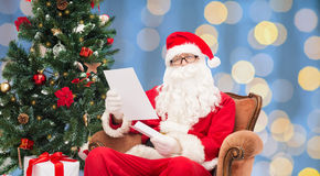 Man in costume of santa claus with letter Stock Photos