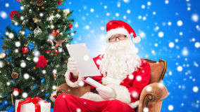 Man in costume of santa claus with letter Royalty Free Stock Photo