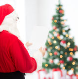 Man in costume of santa claus with letter Stock Image