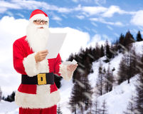 Man in costume of santa claus with letter Stock Images