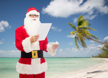 Man in costume of santa claus with letter Stock Photography