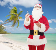Man in costume of santa claus with notepad Royalty Free Stock Photography