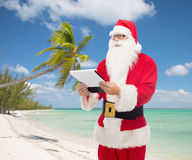 Man in costume of santa claus with notepad Royalty Free Stock Photo